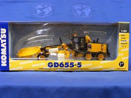 komatsu gd655 5 motor grader w v plow wing