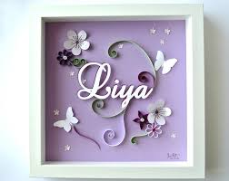 handmade personalized frame with baby name and decorations made out of paper made by brin de