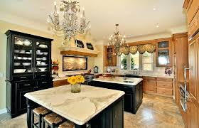 stupendous two island kitchen layouts with wrought iron chandeliers also black wooden display cabinet and ikea