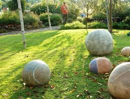 tel aviv mediterranean outdoor landscape with rock wall ceramic garden statues and yard art artwork