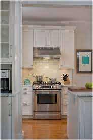 traditional kitchen how high do you hang a range hood from 36 tall kitchen