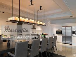 long dining room table with candle chandelier stock photo on long dining room chandeliers