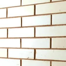 white brick tiles for kitchen backsplash with grey grout