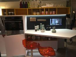 white countertop bar and orange chairs