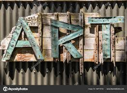 closeup of letters art on corrugated iron fence photo by pstedrak