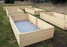 the bottom of your raised garden bed