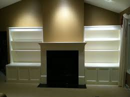 custom made build in media cabinets shelving fireplace mantel surround