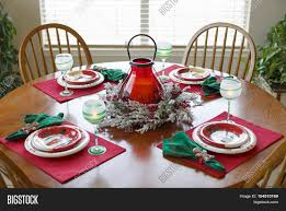 christmas centerpieces for round tables. Christmas Holiday Dining Dinner Setting Arrangement Table. Set For Four On The Round Centerpieces Tables E