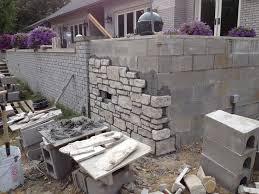 cinder block retaining wall stone facade design facades garden ideas