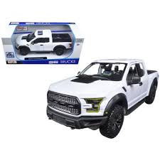 2017 Ford Raptor <b>Pickup Truck</b> White <b>1/24 Diecast</b> Model Car By ...