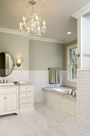 comely crystal bathroom chandelier mixed with white brick backsplash and molding platform bathtub