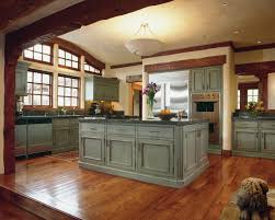 panel l shaped traditional distressed kitchen cabinets mahogany varnished wooden flooring clear glass tall vase flower 1 light pendant big white glass