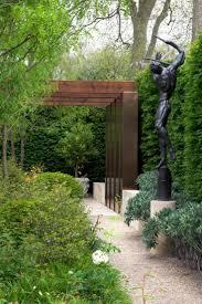 Modern Arbor Design Sleek Modern Arbor Accented By A Harmonious Statuary