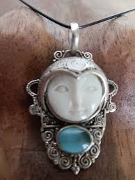 bali moon face pendant in 925 silver with a face carved from buffalo bone and set