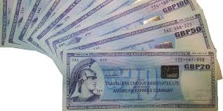american express traveler s cheques in a variety of currencies photo