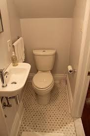 Small powder room note the half size but still stylish sink