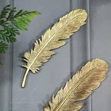 gold metal feather wall art
