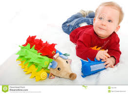 Happy baby boy (6 months old) playing with soft toys, smiling. Toys are property released. Baby toys stock image. Image of blond - 7627787