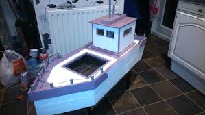 build your own garden boat planter out of pallets other recycled bits