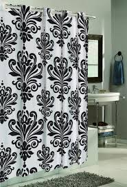 charming oval chrome shower curtain rod designer fabric shower curtain round mirror on gray wall white