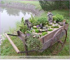 This wheelbarrow made a great container to build a Fairy Garden Community  in!
