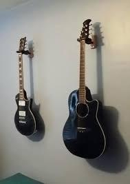 off the wall guitar hanger woos hanger wall mount guitar