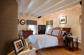 plug in track lighting bedroom contemporary with beamed ceiling bedside table