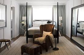 chair in front of bed. bed in front of window chair r