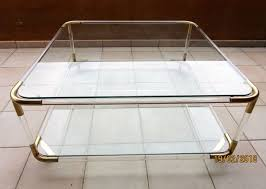 unknown designer side table with two glass surfaces with brass and plexiglass perspex edges
