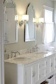 love mirrors sconces sparkle marble elegance and looks so clean golden boys and me master bathroom with pedestal tub white subway tile carrera with bathroom lighting and mirrors