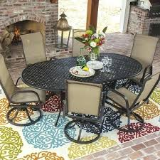 bay 7 piece sling patio dining set with swivel rockers and oval table by outdoor designs