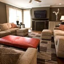 Burnt Orange Accents Pop in Brown Living Room