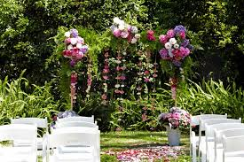 a wedding arch not only creates a wonderful space under which to say your vows but also provides an ideal frame for your photographs