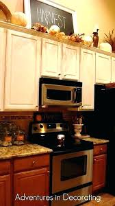 top of kitchen cabinet decor ideas over the above ide
