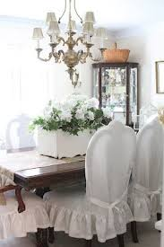 dining room table chair covers. love the slip covers over dining room chairs table chair