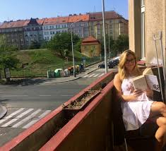 photo essay cet prague cet academic programs photo of my roommate katie gold reading some of the famous czech author franz kaka works for our cet literature on our balcony off our bedroom