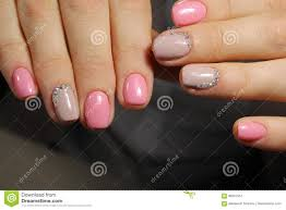 Light Pink Nails With Rhinestones Light Pink Nails With Rhinestones Manicure Design Stock