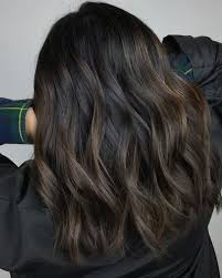 black hair with highlights trending in