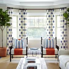 long white curtains with blue polka pattern for glass windows placed on the white wall plus