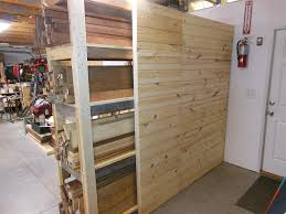 i created a wall on one side using tongue and groove boards shelves and cubbies will be added at a later time a portion was left exposed so that i can see
