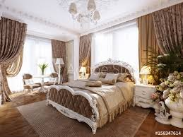luxury classic modern bedroom interior design with beige walls silver fixtures accessories white silver furniture baroque stucco fretwork decorations on