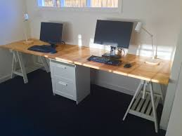 office desk for home use. Long Home Office Desk Made From Two IKEA Gerton Beech Table Tops, With Support For Use