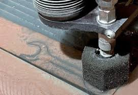 compressibility examples. an abrasive water-jet cutter puts the final cuts on a special tool that is compressibility examples