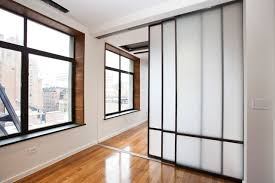 Sliding glass doors - New York City Greenwich Village Modern Loft luxury  renovat contemporary-bedroom