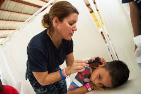 u s department of defense photo essay u s navy capt mary white performs a medical exam on a child at a medical