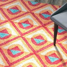 A Red And Turquoise Rug Orange
