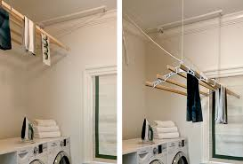 splashy wall mounted clothes drying rack in laundry room traditional with indoor swing next to ceiling mounted barn door alongside ceiling mounted curtain