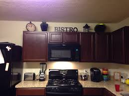 Decor Over Kitchen Cabinets Above Cabinet Decor Kitchen Decorations Pinterest Jars