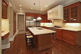 cherry kitchen cabinets with dark wood floors