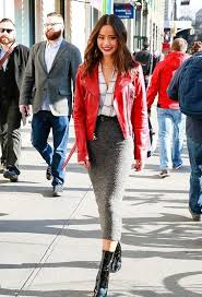 a checked shirt a red leather jacket a grey pencil midi skirt black